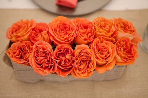 Orange roses are gorgeous to cluster or tuck in other arrangements. (www.stylemepretty.com)