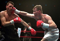 Junior Welterweight Mickey Ward, right, of Lowell, Mass., lands a punch to the face of Lewis Veader, of Providence, R.I., during a World Boxing Union Championship bout in Boston, Saturday, April 13, 1996. Ward defeated Veader in the 9th round. (AP Photo/Jim Rogash)