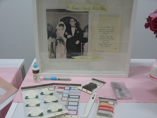 Just a few items from our Martha Stewart Crafts line available at Michael's, and one of Darcy's scrap boxes. This one features a wedding photo and invitation from her parents' wedding.