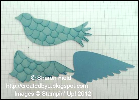three pieces created prior to stamping an assembly of elegant bird