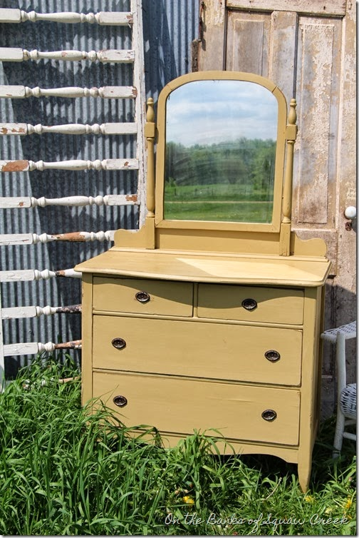 yellow antique dresser