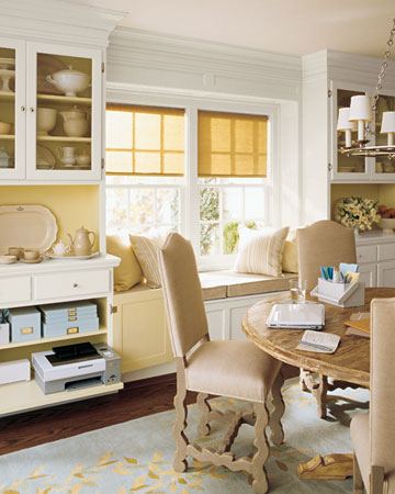 Dining room shelving doubles as a home office.