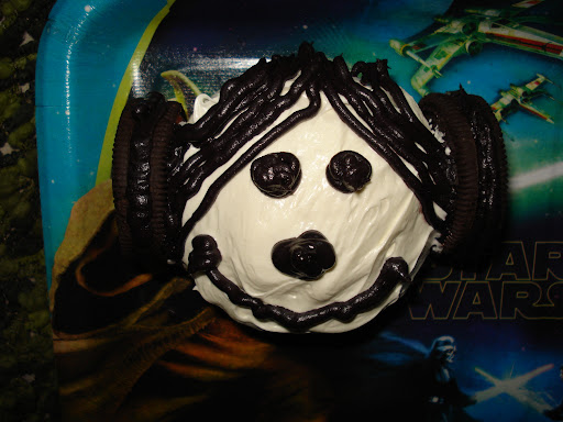 MAY THE FROSTING BE WITH YOU: Christine Eads co-host of Broadminded on Sirius XM Stars presents her Princess Leia cupcake. Her unforgettable hair buns are courtesy of Double Stuff Oreo cookies with chocolate icing in the middle to keep her natural color.