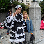 strange Japanese guy dressed as lolita on Jingu Bridge in Harajuku, Tokyo, Japan