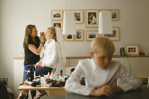 After getting her hair done (and affixing her cathedral-length veil to her head), the bride returned to her parents' condo to get her makeup done by Maria, who is the brand manager of MAC Cosmetics in Iceland.
