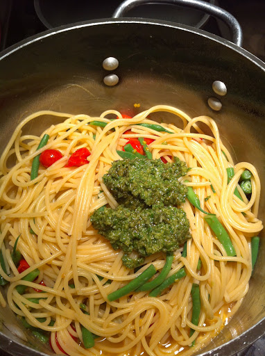 Adding the pesto
