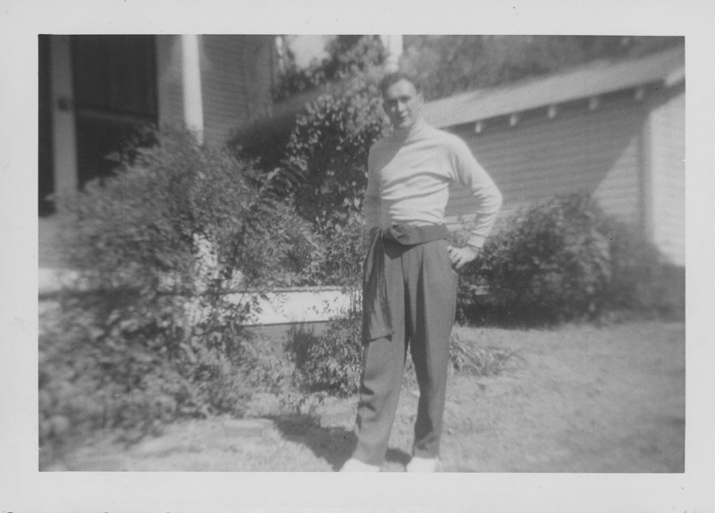Dirk posing outside of a house. Circa 1950s.
