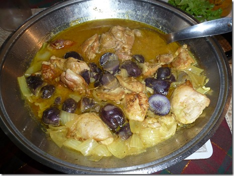 Purple congo potatoes halved and cooked in a chicken curry