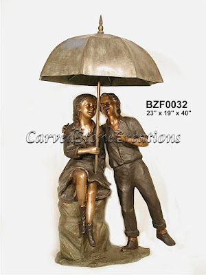 Boy & Girl with Umbrella Fountain