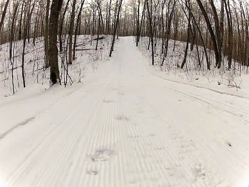 If you walk down a hill, please do so on the side of the traill off the packed. WIth the lower base, it is difficult to remove foot prints grooming. Thanks!