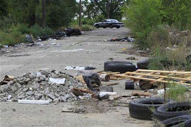 Abandoned lots, alleys and neglected parks in Detroit used to be a favorite destination for discarded tires and trash. But over in 2012 they have become dumping grounds for the dead. Carlos Osorio / AP