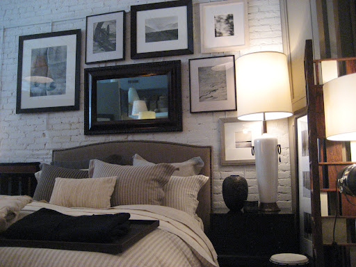 Lots of great framed photography hang on the painted exposed brick walls.