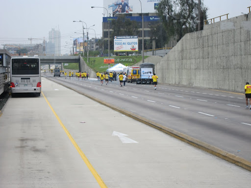 Runners taking over the expressway in Lima - the Metropolitano bus service runs exclusively in the lanes at left