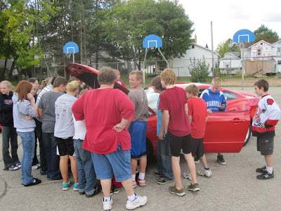 Pretty cool to see this many kids crowded around my car - makes you remember what it was like to be in their shoes.