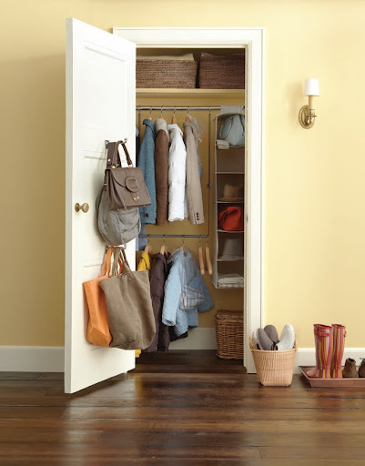 This entry way has a a Double Hang Closet Rod ($9.99 from The Container Store) -- it provides the perfect extra space to hang double the amount of coats your closet usually can store. Extra hooks on the door come in handy for hand-bags and hanging scarves.