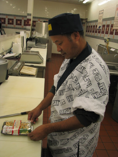 Ngun with a finished package of sushi in Price Cutter. Ngun makes sushi for the store to support his family and help several other families in Springfield who came to the United States from Myanmar as refugees.