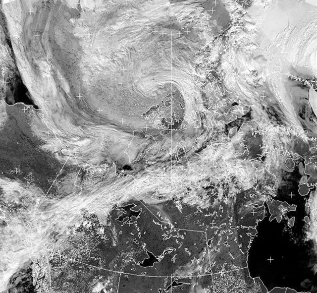 A cyclone (top centre) forms over the Canadian Arctic in an Environment Canada NOAA satellite imagery taken at 15:42 Eastern time on Thursday, 25 July 2013. Photo: THE CANADIAN PRESS / HO