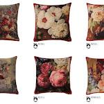 Poduszki gobelinowe w tradycyjne wzory kwiatowe.
