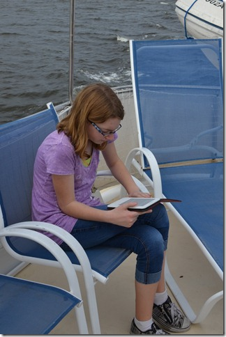 Mirelle enjoying her Kindle on the deck