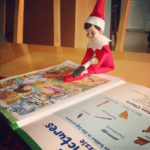 Elf on the Shelf with a magazine