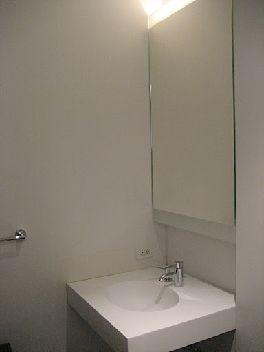 The powder room has built in lighting behind the medicine cabinet mirror.