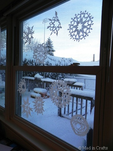 paper snowflakes on the window