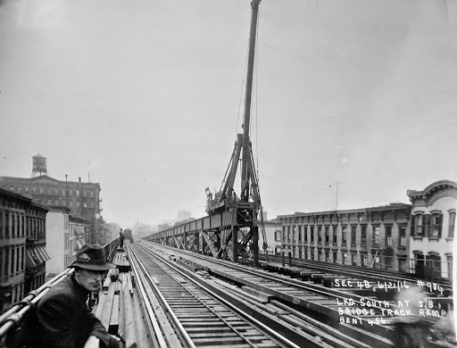 June 21, 1916 SW view of the 2nd Ave El at 55th St showing the erection of the ramp for the inbound trains Queens from the fly-over and the 57th St upper level station.  The structure was expanded to four tracks to accommodate the Queensboro Bridge fly-over and the upper level platform.