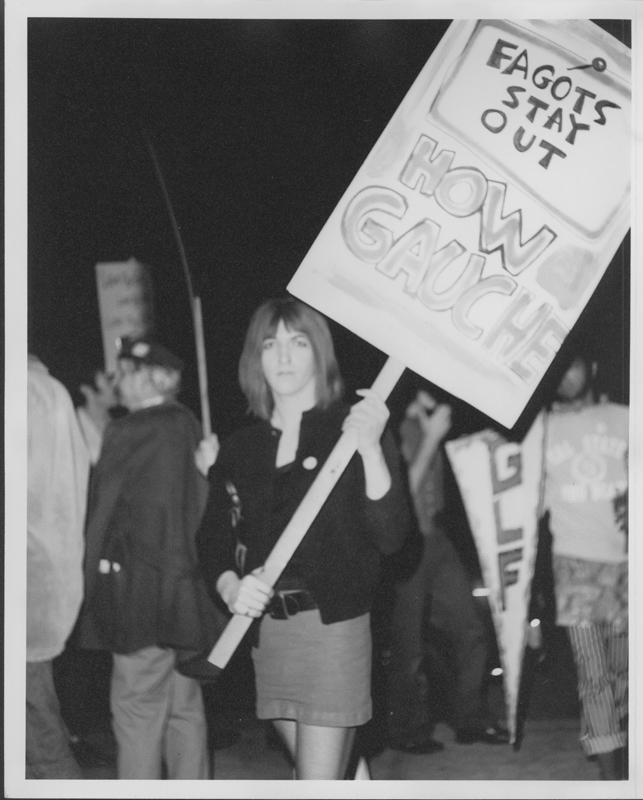 "Angela Douglas and the Gay Liberation Front (GLF) picket Barney's Beanery regarding their posting of ""Fagots [sic] Stay Out"" signs. 1969."