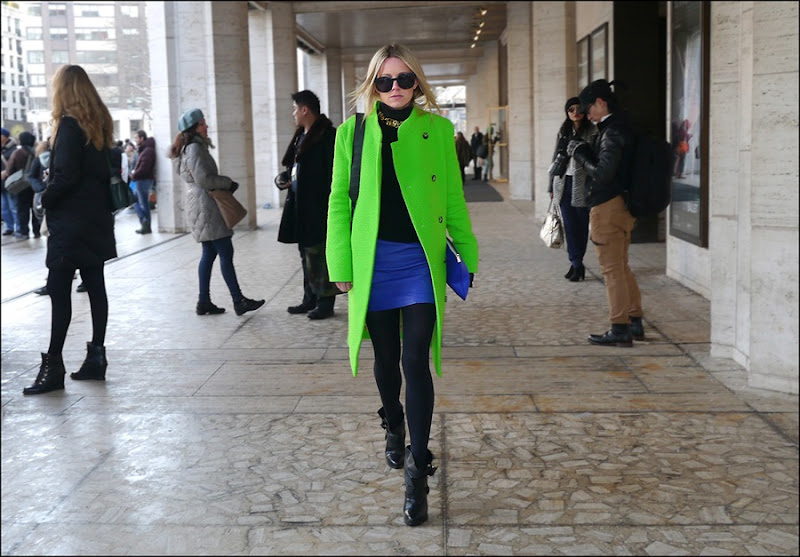 13 w lime green coat blue leather mini black leggings black t neck black ankle boots blue clutch big black sunglasses ol
