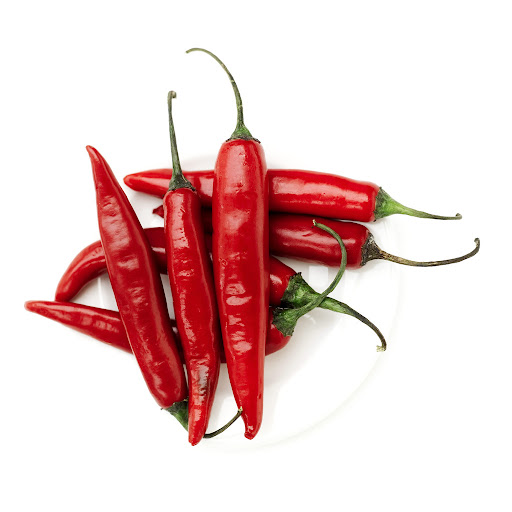 Plate of Red Chili Peppers --- Image by © Royalty-Free/Corbis