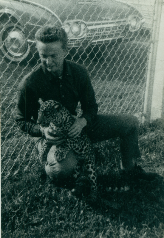 Reed Erickson with his pet leopard Henry. Circa 1950s.