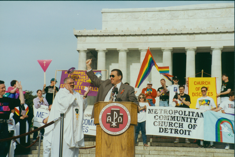Metropolitan Community Church (MCC) leader speaks at the March on Washington with Troy Perry in white vestments. April 25, 1993.