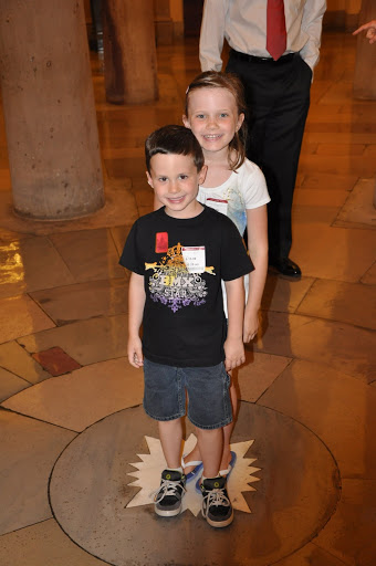 Eli and Natalie stand in the center of the crypt...the center of DC.