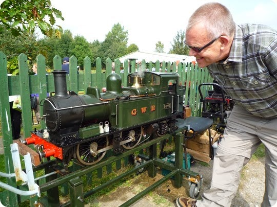 Visitor Mark Ray inspects a scale-model locomotive