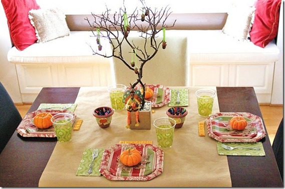 Thanksgiving kids table decorating and activity ideas--colorful table with guessing game and cheese cracker place cards
