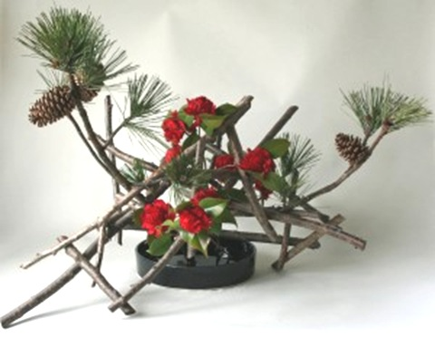 pine and camelia ikebana arrangement