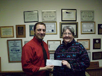 KCII's General Manager Joe Nichols with Rose Fisher of Kalona