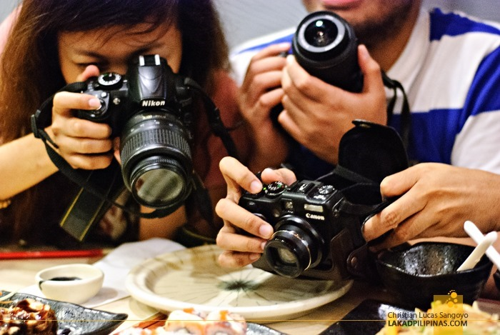 Shoot First, Eat Later. Dang Travel Bloggers!