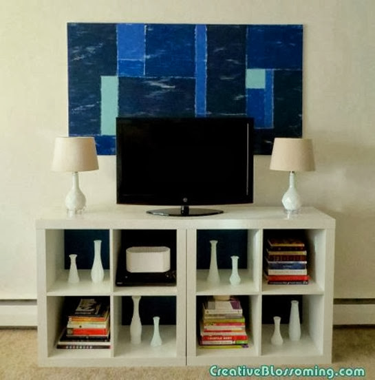 diy-distressed-color-block-wall-art-and-expedit-bookcases-with-blue-backing-001
