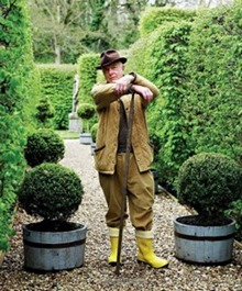 Nicky Haslam in the garden of his country house.