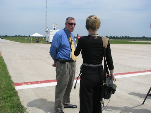 Gary Cyr, director of aviation at the Springfield-Branson National Airport, is interviewed by KSMU's Jennifer Moore. Cyr said the drill gives all agencies involved a chance to check their various responses, and to make sure they can all communicate with one another.