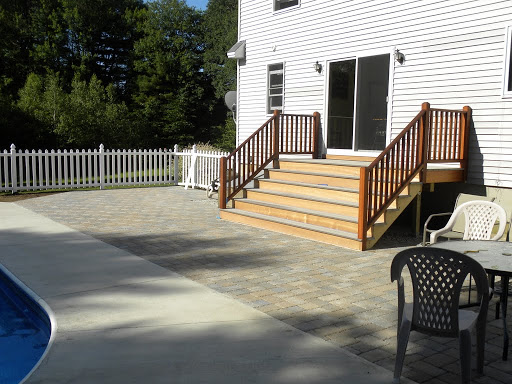 Close up of pavers and large open steps that welcome you down onto the patio