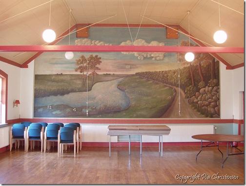 Maleri af Jens og Kaj Andersen på væggen i Tårs Forsamlingshus