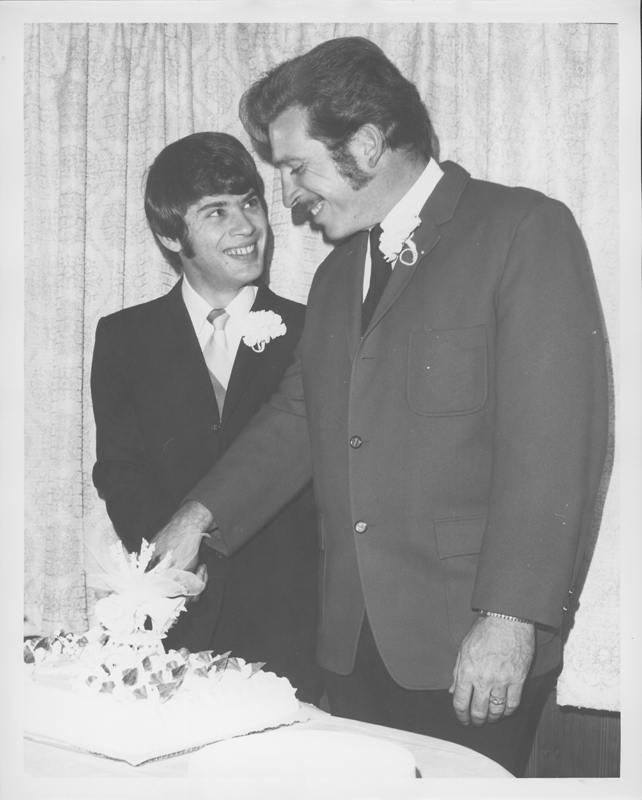 Ron Douglas (left) and Jack Wilson cut their wedding cake at the private marriage ceremony. 1970.