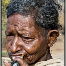 Orissa by Diego Scaglione - People Portraits of Men ( ash, smoking, earring, pipe, man )