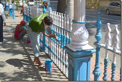 Painting rails outside treasury building