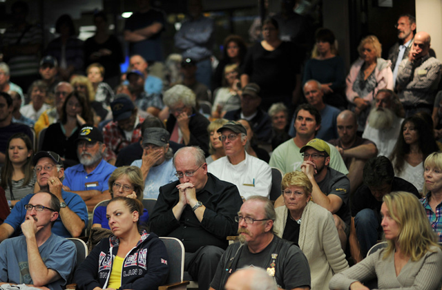 Lyons residents attend a meeting at Civic Center Complex in Longmont, Colorado, 19 September 2013. Photo: Hyoung Chang / The Denver Post