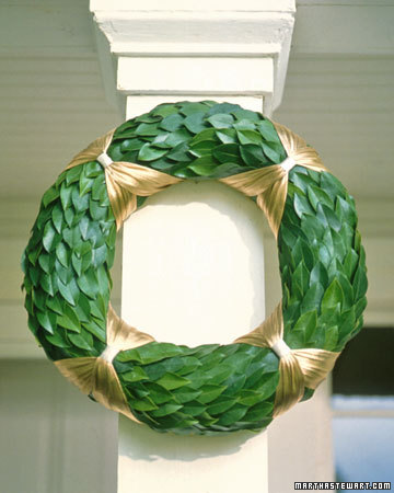Padding a wire wreath with straw or hay creates a full, rounded base that can support a variety of materials. This one is made with laurel, although a straw wreath is so beautiful, you may want to hang it on its own.