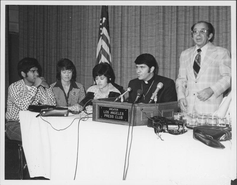 Al Gordon (right) at the Los Angeles Press Club announcing his plan to challenge the unequal enforcement of sex laws.  Seated (left to right) are Steve Jordan, Barbara Gehrke, Jeanne Cordova and Reverend Troy Perry.  June 1974.