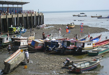 Boat repair at low tide